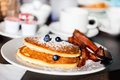 Blueberry pancakes delicious and bacon served for breakfast Stock Photos