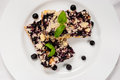 Blueberry pie bilberry hucklberry or cake on white plate Stock Images