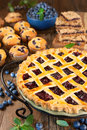 Blueberry pie close up of a surrounded by fresh berries and baked goods Stock Photo