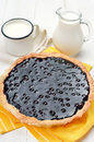 Blueberry pie and milk on white wooden table Royalty Free Stock Photo