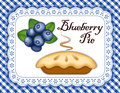 Blueberry pie ripe fruit on white eyelet lace doily place mat blue gingham check background fresh baked sweet dessert treat Royalty Free Stock Image