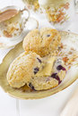 Blueberry Scones with Butter and a Cup of Tea Royalty Free Stock Photo