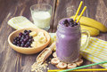 Blueberry smoothie with banana and oat flakes Royalty Free Stock Photo