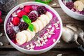 Blueberry smoothie bowl with banana, raspberry, pitaya, blackberry, almonds, sunflower and chia seeds Royalty Free Stock Photo