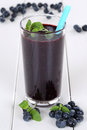 Blueberry smoothie fruit juice with blueberries fruits Royalty Free Stock Photo