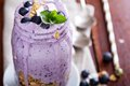 Blueberry smoothie with fruits and granola in jar Stock Photography