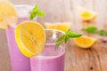 Blueberry smoothie with lemon and mint Royalty Free Stock Images