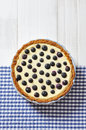 Blueberry tart on checkered background top view Royalty Free Stock Photo