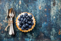 Blueberry tart and teaspoons Royalty Free Stock Photo