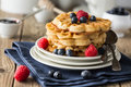 Blueberry waffles with raspberries for breakfast Stock Photo