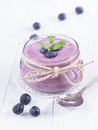 Blueberry yoghurt in a glass Stock Image