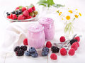 Blueberry yogurt with fresh berries on wooden table Stock Photo