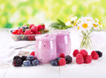 Blueberry yogurt with fresh berries on wooden table Royalty Free Stock Photography