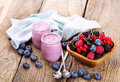 Blueberry yogurt with fresh berries on wooden table Royalty Free Stock Images