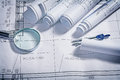 Blueprints magnifer and compass close up Royalty Free Stock Photo