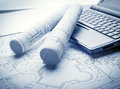 Blueprints rolls and laptop Royalty Free Stock Photo
