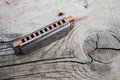 Blues harmonica on a wooden background Royalty Free Stock Photo