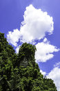 Bluesky with green moutain and fufy clouds Stock Photo