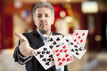 Bluff handsome man playing with poker cards Royalty Free Stock Image