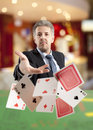 Bluff handsome man playing with poker cards Stock Photography