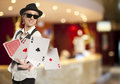 Bluff happy woman in cap playing with poker cards Royalty Free Stock Image