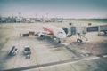 Blur background aircraft and loading unloading area Royalty Free Stock Photo