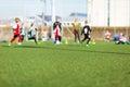 Blur of boys playing soccer