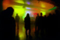 Blur defocused silhouettes of young people on dj concert fans watching electronic music performing stage Stock Image