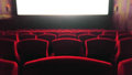 Blur Movie Theater with Red Chairs used as Template Royalty Free Stock Photo