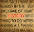 Blured text on vintage paper with focus on HISTORY Royalty Free Stock Photo
