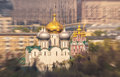 Blurred abstract view of orthodox church with golden cupola inside the moscow city under spring sun light a an Royalty Free Stock Photos