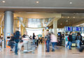 Blurred advancing people in airport installations Royalty Free Stock Photo