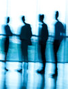 Blurred businesspeople image of a business team standing at the office Stock Images