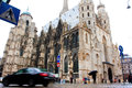 Blurred car quickly passes against the cathedral i black magnificent st stephens in vienna in rain Stock Images