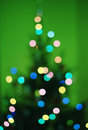 Blurred christmas tree in green Royalty Free Stock Photo