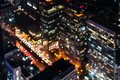 Blurred city light in aerial view. Abstract bokeh defocused background urban night building light at business center bangkok in Royalty Free Stock Photo