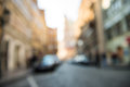 Blurred city road background with cars and shops Royalty Free Stock Photo