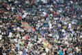 Blurred crowd of spectators on a stadium Royalty Free Stock Photo