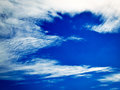 Blurred dreamy clouds in the blue sky Royalty Free Stock Photo
