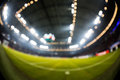Blurred field with lights and full of spectators at the stadium Royalty Free Stock Photo