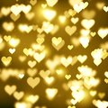 Blurred gold bokeh background, yellow hearts, gold, glitter, holiday, glamour, glow, light effect