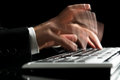 Blurred hands typing Royalty Free Stock Photo