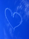 Blurred heart in blue sky skywriting of a the clear through aerobatic maneuver the wind already started to blur this artwork Stock Image