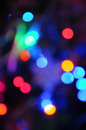 Blurred holiday lights multi colored christmas against a black background Royalty Free Stock Image