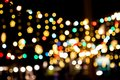 Blurred image Decorative outdoor string lights hanging in the garden at night time festivals season Royalty Free Stock Photo