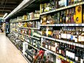 stock image of  Wine shelves with price tags on display at store in Kharkov, Uktaine. Defocused rows of Wine Liquor bottles on th