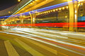 Blurred light trails under the overpass Stock Images