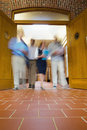 Blurred people walking through open doors low angle view of a group of Royalty Free Stock Image