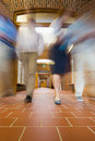 Blurred people walking through open doors low angle view of a group of Royalty Free Stock Images