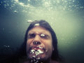 Blurred photo of drowning man in water Royalty Free Stock Photo